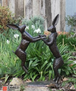 recycled metal hares jumping